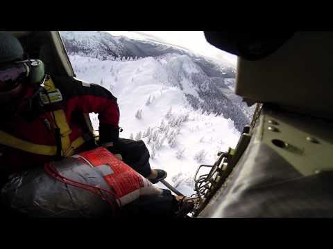 Watch Avalanche Control Throw a Bomb From a Moving Helicopter and Set off a Massive Slide