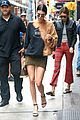 kendall jenner shows off her legs in olive green skirt and oversized sweatshirt 01