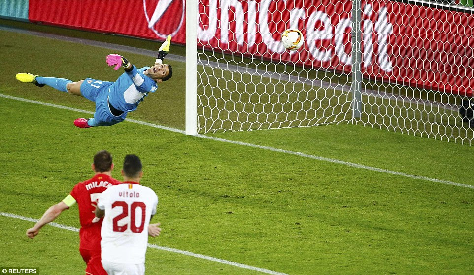 Sevilla keeper Soria dives in vain as Sturridge's shot screams past him and into the corner to hand Liverpool a first-half lead