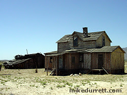 We recall these buildings as the ranch in ''Monte Walsh,'' making them among the oldest structures on the property. The barn is near collapse. The house is a heap. Lee Marvin would not be pleased. Photo copyright 2003-2004 Mike Durrett, all rights reserved.