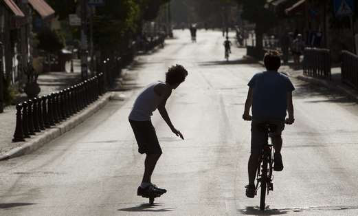 Youths ride in Jerusalem on Yom Kippur