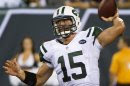 Jets quarterback Tim Tebow passes against Panthers in pre-season NFL football game in East Rutherford