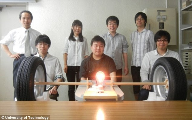 Bright idea: The team, led by Professor Takashi Ohir (centre), with their invention