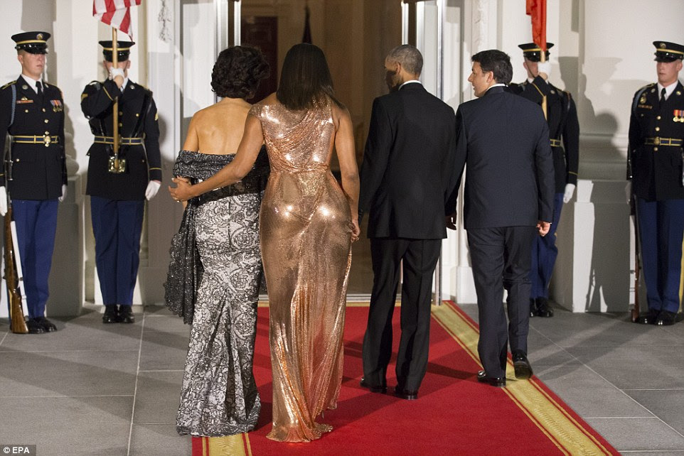 President Barack Obama and First Lady Michelle Obama enter the White House at the North Portico, with Italian Prime Minister Matteo Renzi and his wife Agnese Landini