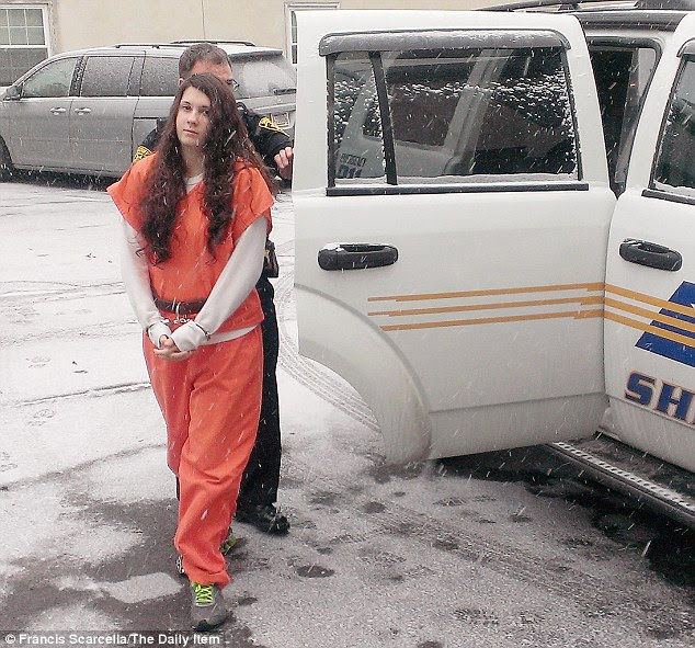 Satanism: Miranda Barbour, 19, pictured Friday, claims she joined a cult aged just 13 in the town of North Pole, where hundreds of news outlets have turned out since the lurid story broke