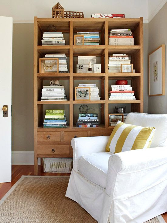 Stacked books serve as pedestals for decorative pieces. More stylish storage ideas: http://www.bhg.com/decorating/storage/organization-basics/charming-hardworking-storage/
