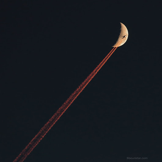 Plane Crossing a Crescent Moon