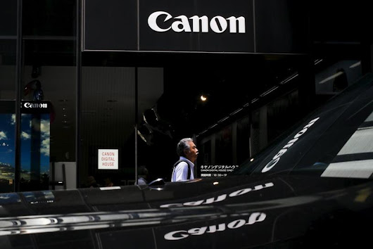 Canon cuts outlook as weak camera sales hit second-quarter profit
