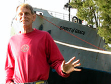 Stuart Ver Wys convalescing. In the background is the Spirit of Grace, the ship that took him to Haiti.