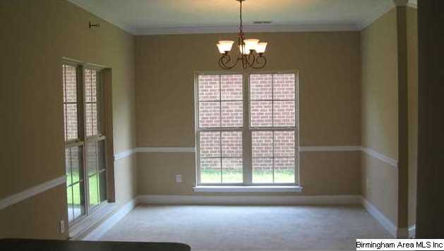 Large, bright, dining room can be casual or formal. Has crown ...