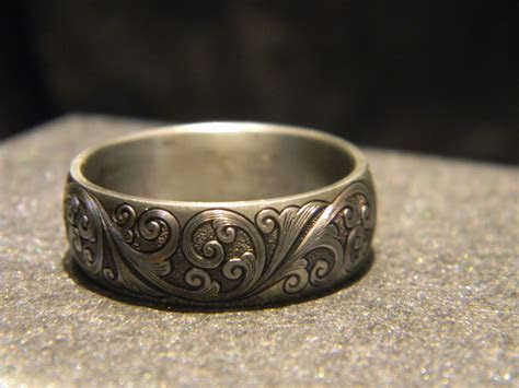8mm titanium engraved ring with JHook engraving Please