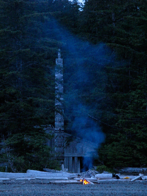 fire on beach in front of Chief Son-i-Hat Whale House, Kasaan, Alaska