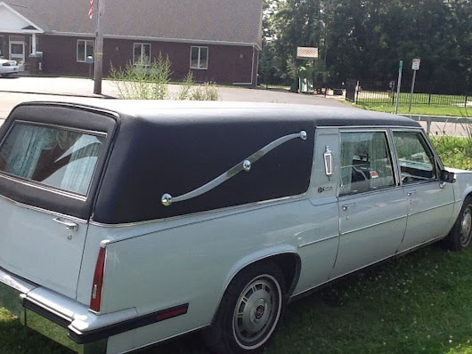 1985 Cadillac Hearse with a Cherry wood coffin