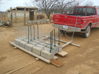 Pig fence sections delivered to pig pen