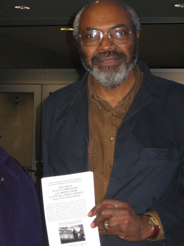 Abayomi Azikiwe, editor of the Pan-African News Wire, holding a leaflet at Cobo Conference Center in downtown Detroit. MECAWI won a federal court order related to its ability to distribute information on the foreclosure crisis. (Photo: Cheryl LaBash). by Pan-African News Wire File Photos
