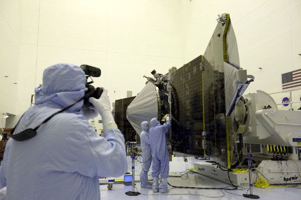 NASA's MAVEN spacecraft is put on display for the media to see at the Kennedy Space Center in Florida, on September 27, 2013.