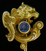 A regal griffin and sapphire stickpin. (J9135)