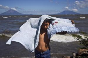 In this Dec. 5, 2013 photo, Elias Munoz, 11, dries…