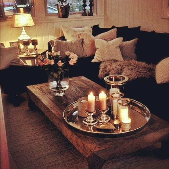 The perfect cozy living room...dark sofa, light walls, light fluffy pillows, plus a little sparkle and bling with the silver accents (tray on coffee table and lamp).