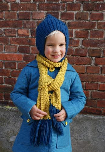 Kijk! Mijn muts én mijn sjaal passen bij mijn nieuwe jas!