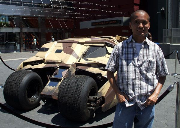 Posing in front of the Tumbler from THE DARK KNIGHT RISES outside of the AMC Citywalk theater in Hollywood, on July 20, 2012.
