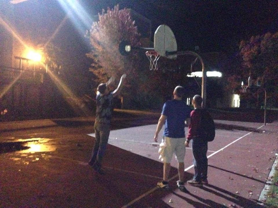 A man tried to balance uprooted light poll on a basketball hoop.