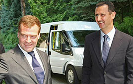 Dmitry Medvedev (L) and Bashar Assad (Photo: AFP)