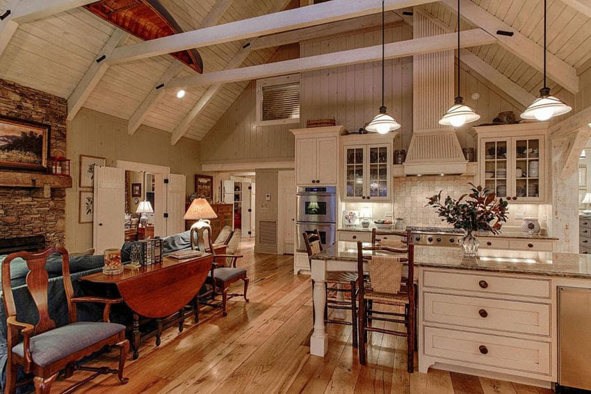 white country kitchen with hickory wood floors rustic island and cathedral ceiling