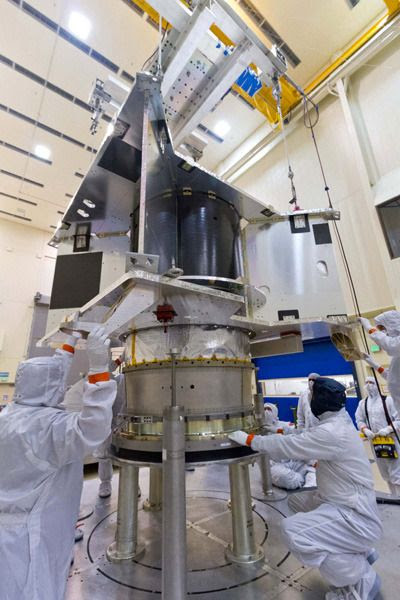 At the Lockheed Martin facility in Littleton, Colorado, engineers are about to combine the OSIRIS-REx spacecraft's core structure with its hydrazine fuel tank and boat tail assembly.