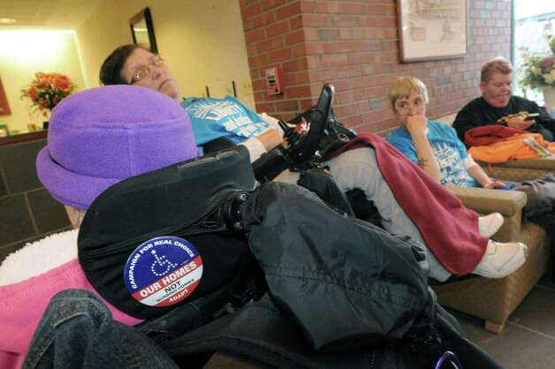 Members of Adapt, a disabilities advocacy group, occupy the NYS Nurses Association Office, upset that nurses won't back an amendment to a bill that would broaden the kind of caretakers who would be able to perform certain tasks that are now limited to nurses, on Thursday March 20, 2014 in Colonie, N.Y. (Michael P. Farrell/Times Union) Photo: Michael P. Farrell / 00026230A