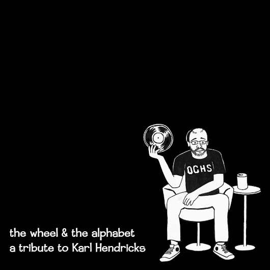 The Wheel & The Alphabet: A Tribute To Karl Hendricks – Comedy Minus One