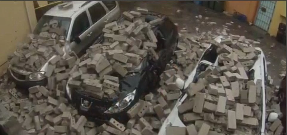 In Narrabeen the storms caused a building to collapse and rain bricks down onto cars parked below