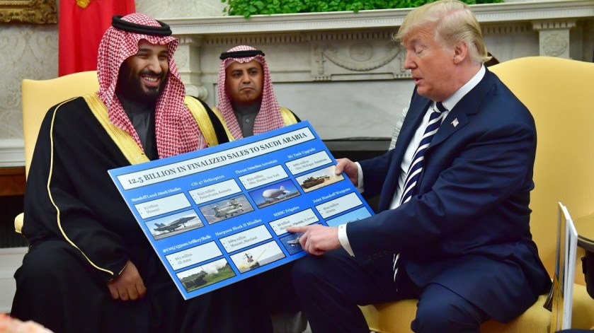 US President Donald Trump holds up a chart of military hardware sales as he meets with Crown Prince Mohammed bin Salman of the Kingdom of Saudi Arabia in the Oval Office at the White House in Washington, DC, USA, 20 March 2018. EPA, KEVIN DIETSCH