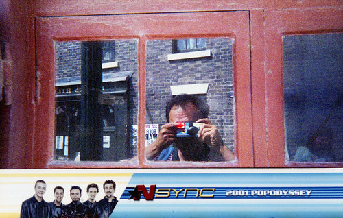 reflected self-portrait with *NSYNC camera and boy band border by pho-Tony