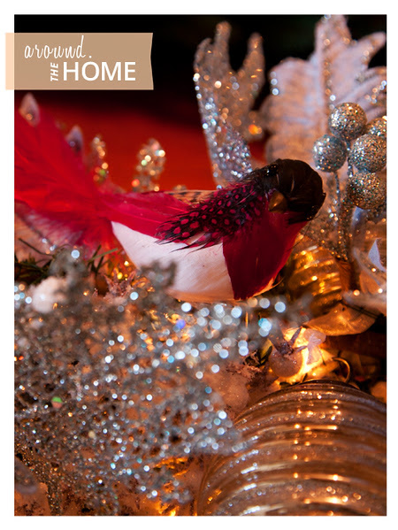 Glass ornaments, feathered birds, and glitter edged leaves from Balsam Hill make holiday decorating a breeze.