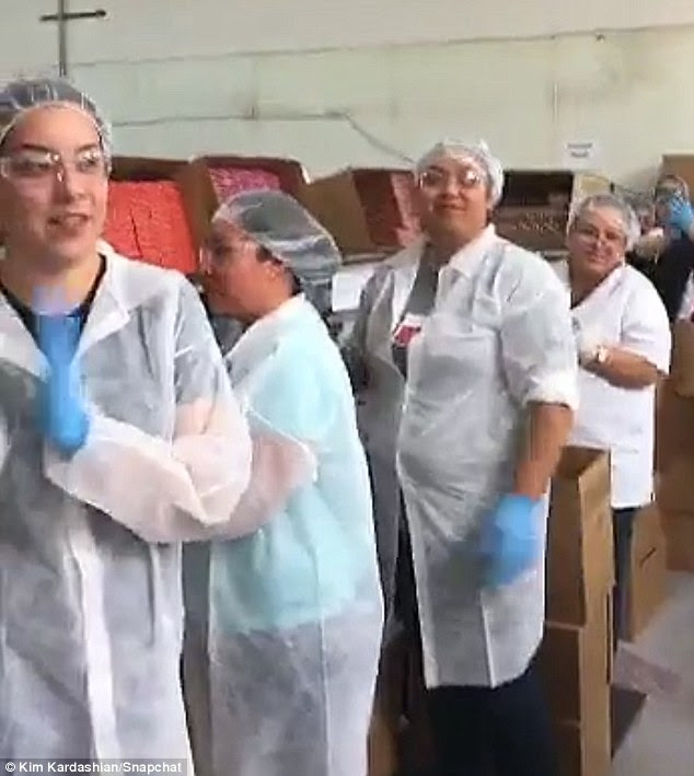 That's how you do it! The workers demonstrated how a hair net should be worn