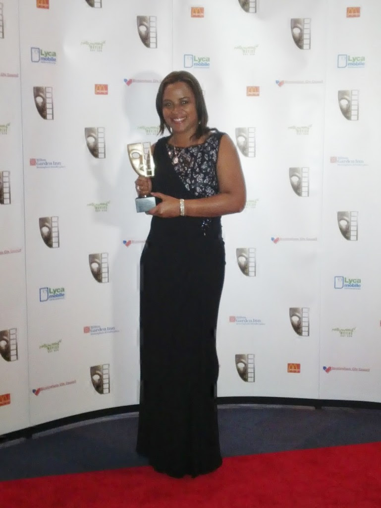 Michelle proudly displaying her award