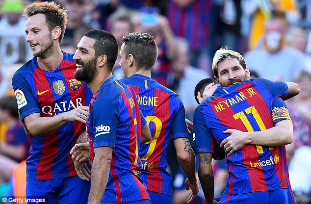 Neymar hugs Messi and the Argentinian is swamped by his team-mates after scoring