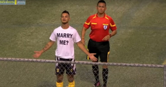 Soccer player gets a yellow card while proposing