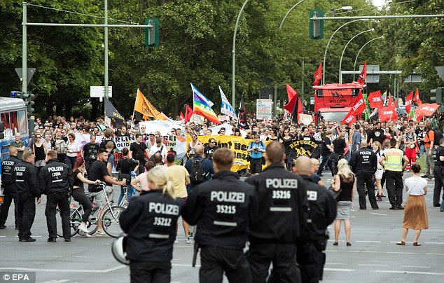 Police manned the streets of Germany, which is still on high alert following the attacks, as right-wing protesters met thousands of counter-demonstrators (pictured, Berlin)