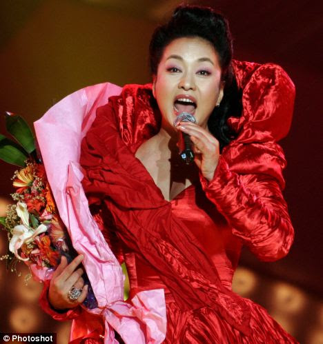 Flamboyant: Xi Mingze's mother Peng Liyuan is a well known singer