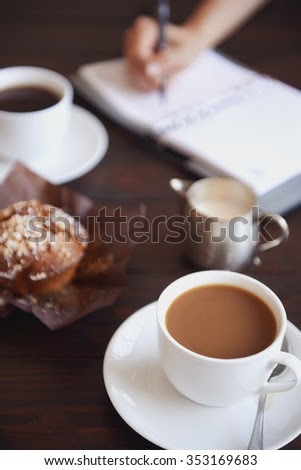 Popular Free Cups of coffee with a muffin and a daily planner in ...
