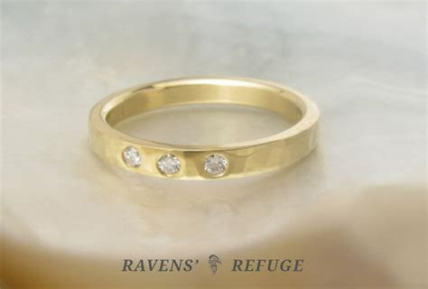 hammered wedding band with flush set diamonds   Ravens' Refuge