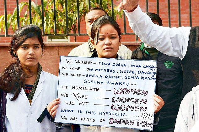 Medics' protest: Medical workers protester at LNJP hospital against the recent gang-rape of a young woman in a moving bus in New Delhi
