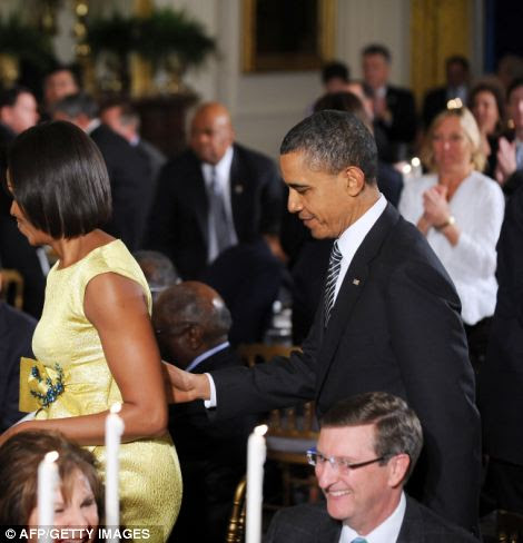 A standing ovation for the President as Barack Obama and First Lady Michelle Obama arrive at a dinner at the White House last night