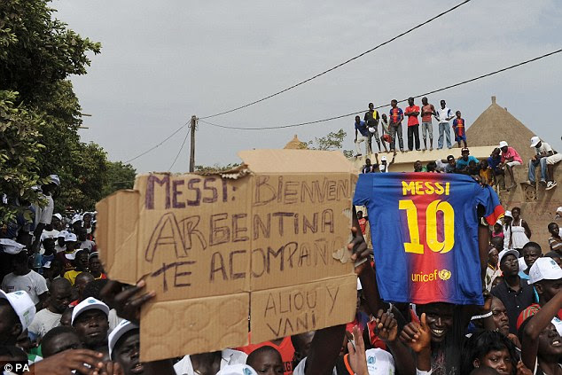 Warm welcome: Messi was there to support the 'Football Combating Malaria' project in the African country