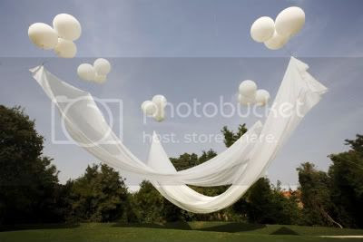 Outdoor Shade with helium balloons by Gustafson Porter