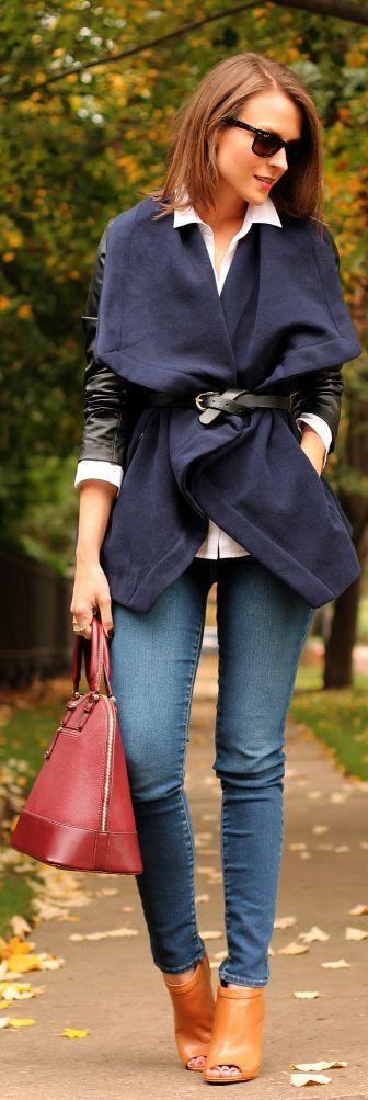 Fall / Winter - street chic style - layers - navy fleece cape coat + black belt + black leather jacket + white shirt + black sunglasses + red handbag + denim skinnies + honey peep toe booties