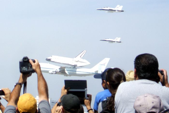A photo I took of Endeavour and NASA 905, plus two NASA F/A-18 chase planes, performing a flyover of LAX on September 21, 2012.