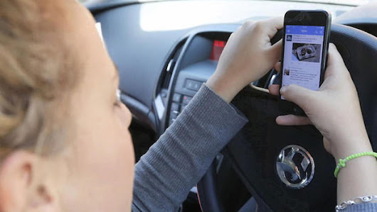 Distracted drivers feel addicted to behind-the-wheel cellphone use, AT&T survey finds